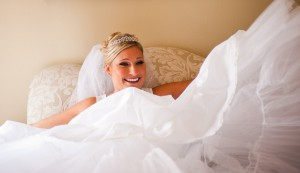 A bride sitting down and laughing