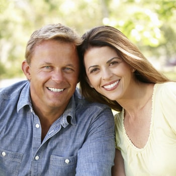 A smiling couple shows how sleep apnea treatment with our Portland dentist can elevate your overall health.