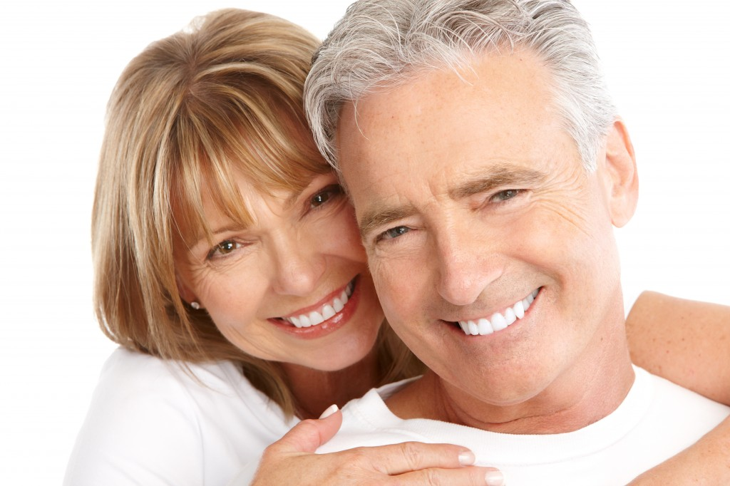 mature couple with perfect smiles thanks to dental implants in Beaverton, OR