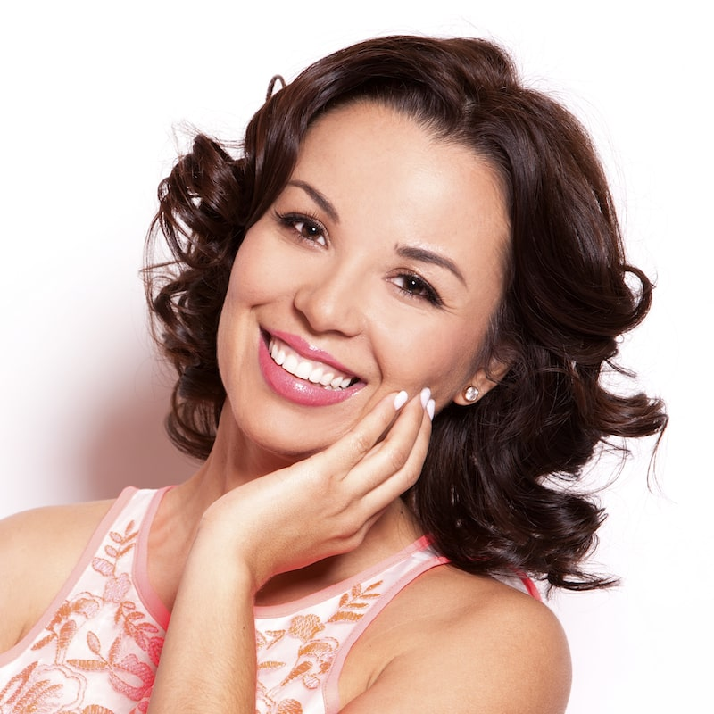 A smiling woman illustrates how our dentists in Beaverton, OR are experts in Cosmetic Dentistry.