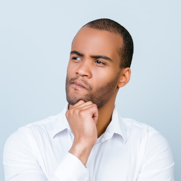 A gentleman looking questioning to illustrate how he is unsure if he can afford dentistry, but Smiles Northwest has solutions for him.