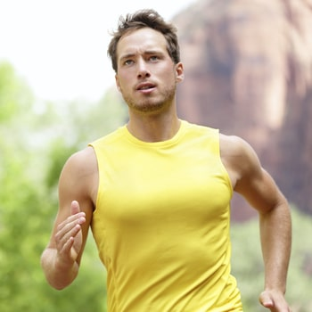 A man running illustrates how sleep apnea treatment helps you fight fatigue.