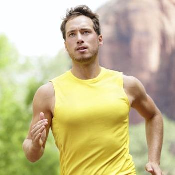 A man running illustrates how sleep apnea treatment helps you fight fatigue.