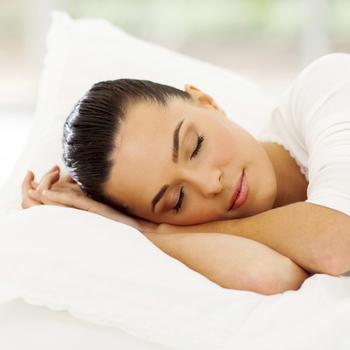 A woman sleeping to show how our Portland Dentist uses sleep apnea treatment to give you a restful night's sleep.