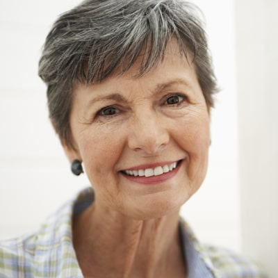 A smiling older woman asks if she is too old for braces